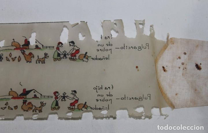 Juguetes Antiguos: PROYECTOR DE CINE NIC EN CAJA NEGRA DE LOS AÑOS 40 CON 17 PELÍCULAS - Foto 11 - 158733858