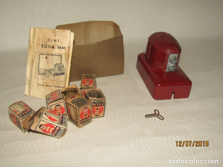 Juguetes Antiguos: Antiguo Proyector de Baquelita a Cuerda Cine Infantil EGDA con 7 Peliculas Año 1930-40s. - Foto 7 - 171804924