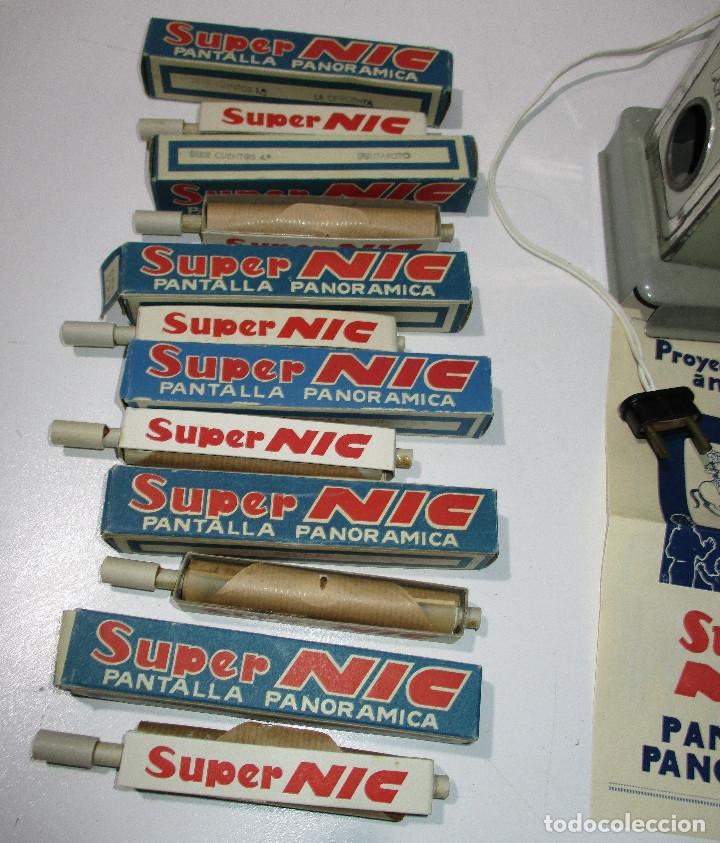 Juguetes Antiguos: Antiguo proyector cine SUPER NIC con 6 películas - Foto 2 - 176182492