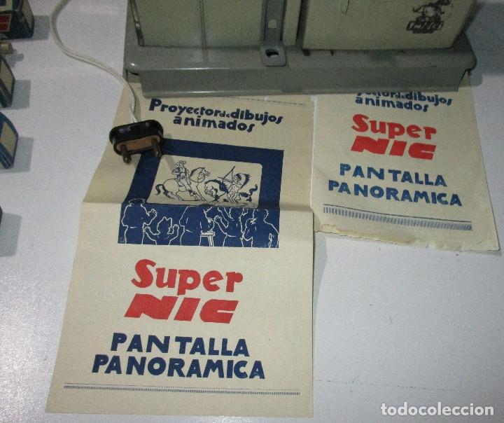 Juguetes Antiguos: Antiguo proyector cine SUPER NIC con 6 películas - Foto 3 - 176182492