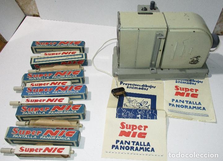 ANTIGUO PROYECTOR CINE SUPER NIC CON 6 PELÍCULAS (Juguetes - Pre-cine y Cine)