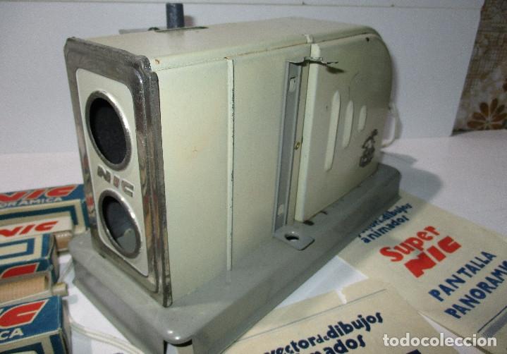 Juguetes Antiguos: Antiguo proyector cine SUPER NIC con 6 películas - Foto 4 - 176182492
