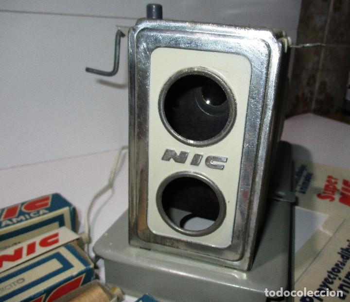 Juguetes Antiguos: Antiguo proyector cine SUPER NIC con 6 películas - Foto 5 - 176182492