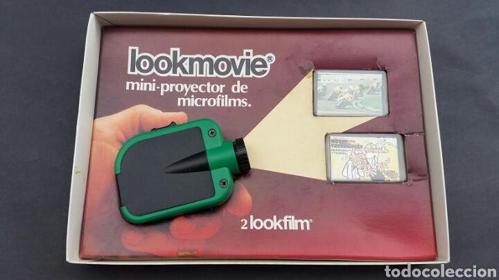 PROYECTOR LOOKMOVIE. LOOKFILM Y 3 CAJITA MICROFILM (Juguetes - Pre-cine y Cine)