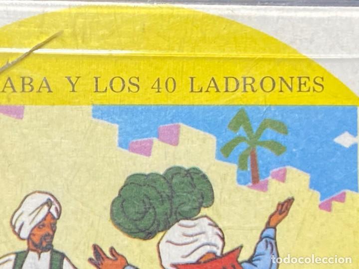 Juguetes Antiguos: PELICULA KODAK IRISCOLOR BARCELONA INFANTIL ALI BABA Y 40 LADRONES 8MMCOLOR 9X9CMS - Foto 3 - 222010792