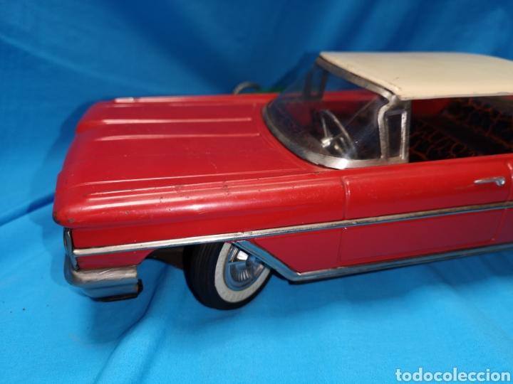 Juguetes antiguos Rico: Precioso coche Oldsmobile de rico cabledirigido. No funciona. Todo metálico. Hojalata. rojo. Años 60 - Foto 9 - 143180788