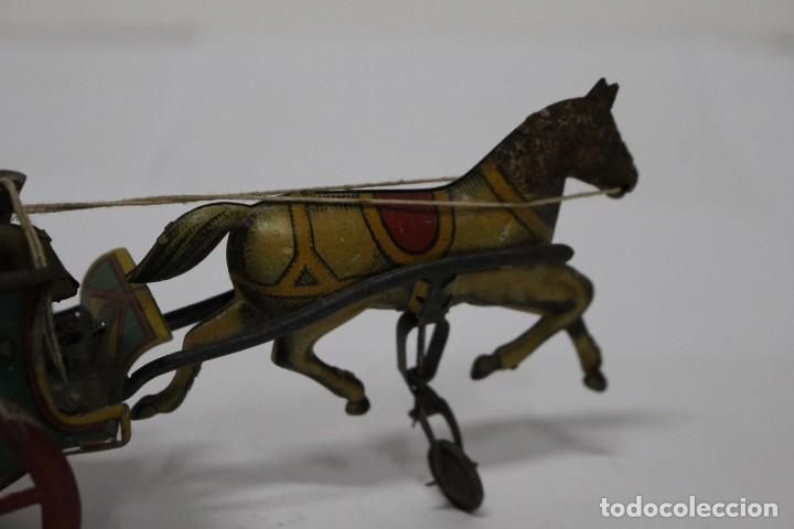 Juguetes antiguos Rico: Antigua carreta o tartana con ruedin de rico. buen estado. - Foto 2 - 189978382