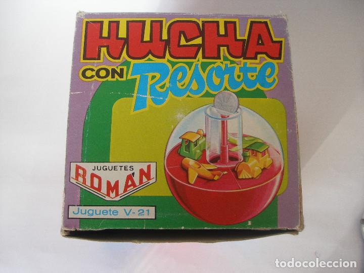 Juguetes antiguos Román: Caja vacía hucha con resorte Román serie Mágicos resortes años 70 - Foto 2 - 103675675