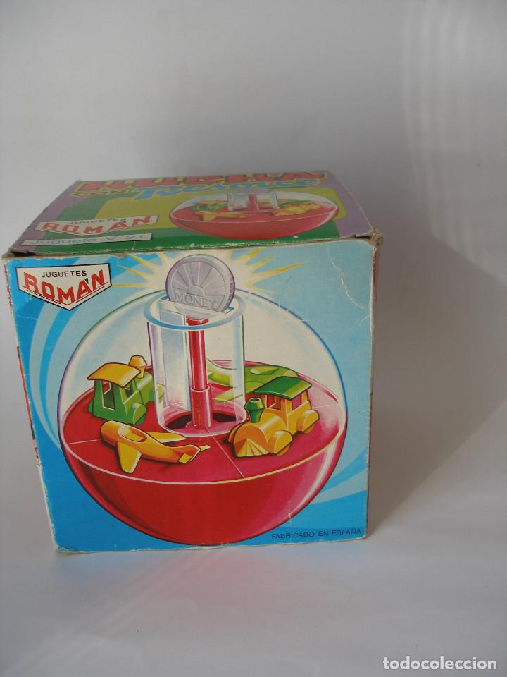 Juguetes antiguos Román: Caja vacía hucha con resorte Román serie Mágicos resortes años 70 - Foto 3 - 103675675