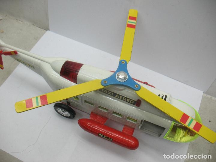 Juguetes antiguos Sanchís: Sanchis Ref: 218 - Helicóptero Frelon Taxi Aereo de plástico con mecanismo a fricción - Foto 5 - 71906771
