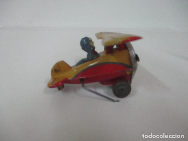 Juguetes Antiguos: Precioso y Raro Avión, Stunt Flyer- Hojalata Litografiada - Marca Suzuki - Made in Mark - Años 40-50 - Foto 2 - 151354206