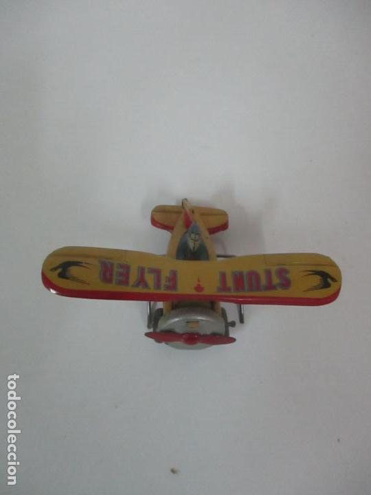 Juguetes Antiguos: Precioso y Raro Avión, Stunt Flyer- Hojalata Litografiada - Marca Suzuki - Made in Mark - Años 40-50 - Foto 3 - 151354206