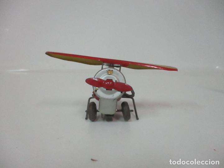 Juguetes Antiguos: Precioso y Raro Avión, Stunt Flyer- Hojalata Litografiada - Marca Suzuki - Made in Mark - Años 40-50 - Foto 13 - 151354206