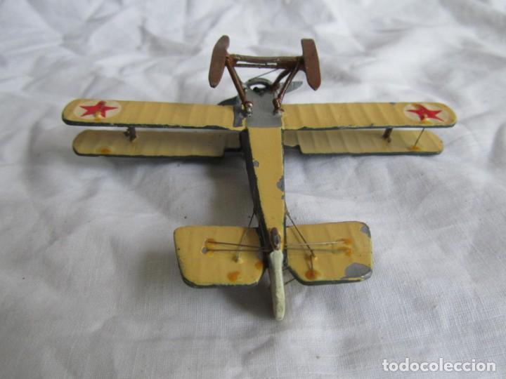 Juguetes Antiguos: Avión de plomo biplano sovietico tren de aterrizaje para nieve N5486 - Foto 9 - 197675802