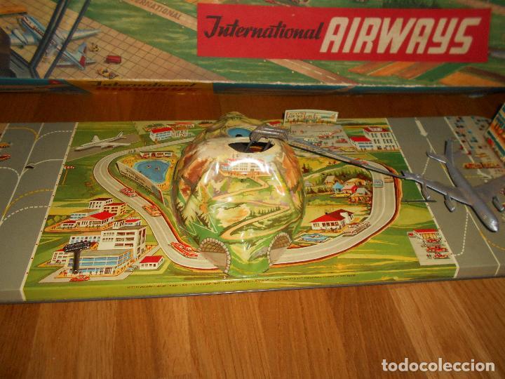 Juguetes antiguos: INTERNATIONAL AIRWAYS HOJALATA AVION WESTERN GERMANY AÑOS 50 TECHNOFIX FUNCIONANDO - Foto 9 - 99385387