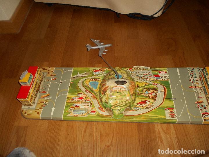 Juguetes antiguos: INTERNATIONAL AIRWAYS HOJALATA AVION WESTERN GERMANY AÑOS 50 TECHNOFIX FUNCIONANDO - Foto 10 - 99385387