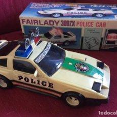 Juguetes antiguos: COCHE ELECTRICO FAIRLADY 300 ZX .POLICE CAR.TOYS MADE IN TAIWAN. AÑOS 90 .NUEVO EN CAJA.NO RICO.PVC. Lote 148765330