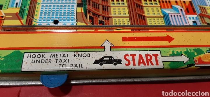 Juguetes antiguos: Overland traffic game. Locomotora-taxi a cuerda. Años 60. Funciona correctamente. - Foto 3 - 47441662