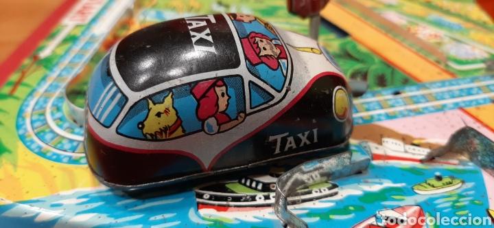 Juguetes antiguos: Overland traffic game. Locomotora-taxi a cuerda. Años 60. Funciona correctamente. - Foto 4 - 47441662