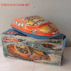 Juguetes antiguos de hojalata: CANOA A RESORTE - CLIM. Lote 27131401