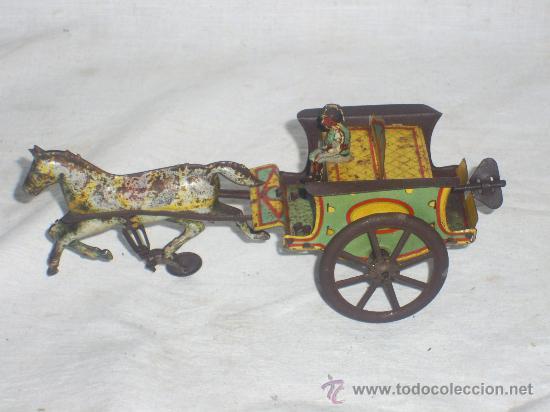 Juguetes antiguos de hojalata: Carro Rico de ojalata con figura. - Foto 2 - 26651978