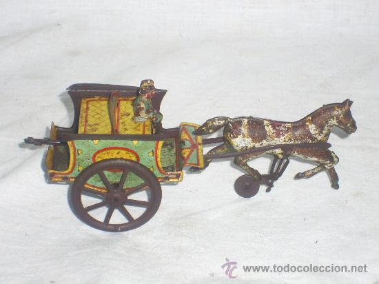 Juguetes antiguos de hojalata: Carro Rico de ojalata con figura. - Foto 3 - 26651978