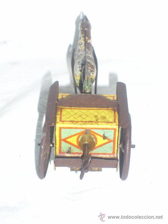 Juguetes antiguos de hojalata: Carro Rico de ojalata con figura. - Foto 4 - 26651978