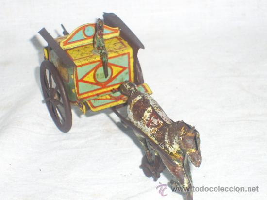 Juguetes antiguos de hojalata: Carro Rico de ojalata con figura. - Foto 5 - 26651978