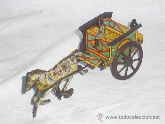 Juguetes antiguos de hojalata: Carro Rico de ojalata con figura. - Foto 6 - 26651978