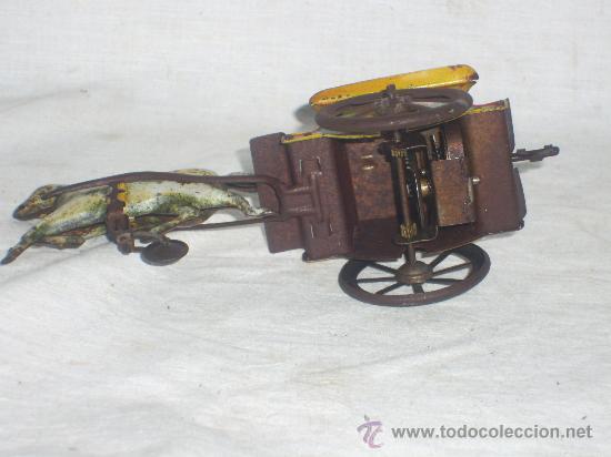 Juguetes antiguos de hojalata: Carro Rico de ojalata con figura. - Foto 7 - 26651978