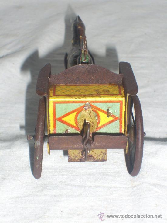 Juguetes antiguos de hojalata: Carro Rico de ojalata con figura. - Foto 8 - 26651978
