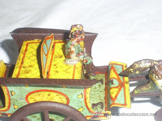 Juguetes antiguos de hojalata: Carro Rico de ojalata con figura. - Foto 9 - 26651978
