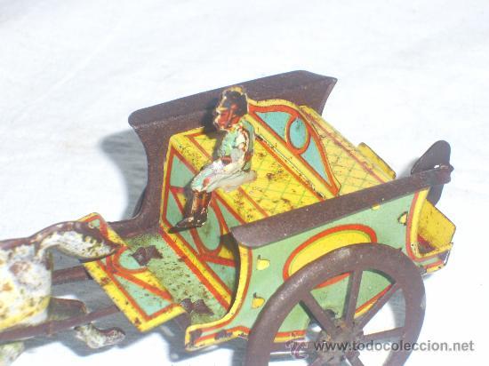 Juguetes antiguos de hojalata: Carro Rico de ojalata con figura. - Foto 11 - 26651978