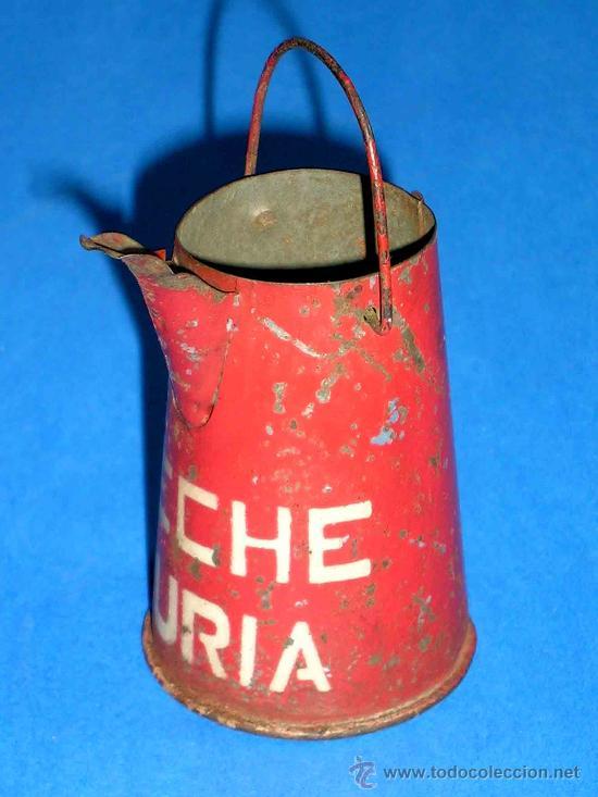 Juguetes antiguos de hojalata: Lechera publicidad alimenticia Leche Nuria, fabricada en lata, probablemente años 1940. - Foto 4 - 27502586