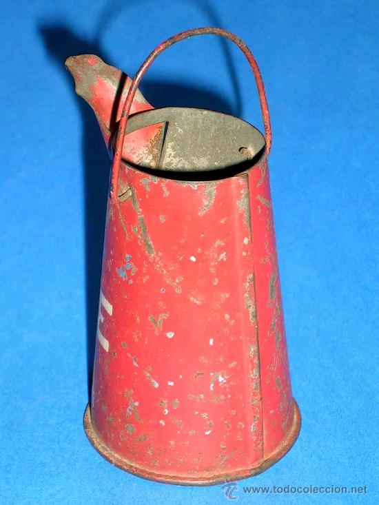 Juguetes antiguos de hojalata: Lechera publicidad alimenticia Leche Nuria, fabricada en lata, probablemente años 1940. - Foto 5 - 27502586