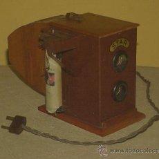 Juguetes antiguos de hojalata: ANTIGUO JUGUETE PROYECTOR DE HOJALATA CINE STAR 1935. Lote 31142256