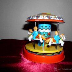 Juguetes antiguos de hojalata: TIOVIVO DE HOJALATA CON MOVIMIENTO. Lote 42566588