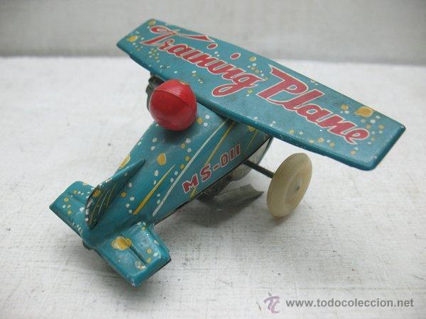 Juguetes antiguos de hojalata: Avion de hojalata litografiada con mecanismo a cuerda Made in China - Foto 3 - 43690566