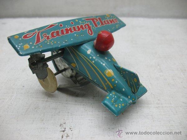 Juguetes antiguos de hojalata: Avion de hojalata litografiada con mecanismo a cuerda Made in China - Foto 4 - 43690566