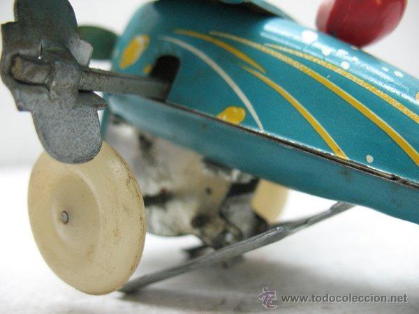 Juguetes antiguos de hojalata: Avion de hojalata litografiada con mecanismo a cuerda Made in China - Foto 5 - 43690566