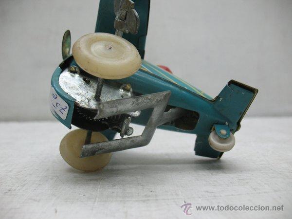Juguetes antiguos de hojalata: Avion de hojalata litografiada con mecanismo a cuerda Made in China - Foto 6 - 43690566