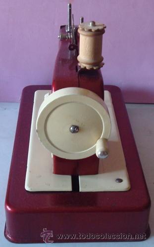 Juguetes antiguos de hojalata: ANTIGUA MÁQUINA DE COSER EN METAL MARCA CASIGE ALEMANA - Foto 6 - 43748111