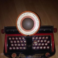 Juguetes antiguos de hojalata: ANTIGUA MAQUINA DE ESCRIBIR DE HOJALATA PARA NIÑOS.TYPEWRITER JUNIOR DIAL.LOUIS MARX NEW YORK. Lote 49354385