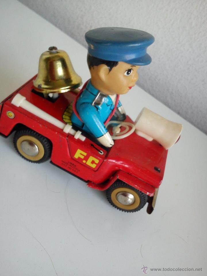 Juguetes antiguos de hojalata: PRECIOSO COCHE PARA COLECION CON EL POLICIA SELADO 653 MS 884MAD CHINE - Foto 2 - 49362159