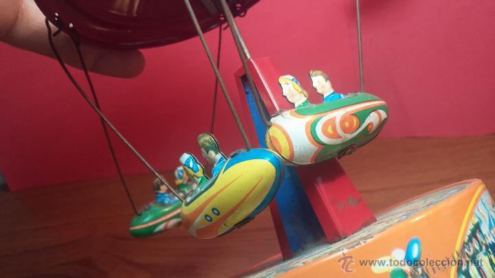 Juguetes antiguos de hojalata: JUGUETE CARRUSEL DE HOJALATA - Foto 2 - 105127448