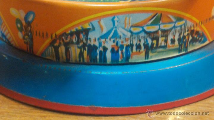 Juguetes antiguos de hojalata: JUGUETE CARRUSEL DE HOJALATA - Foto 10 - 105127448