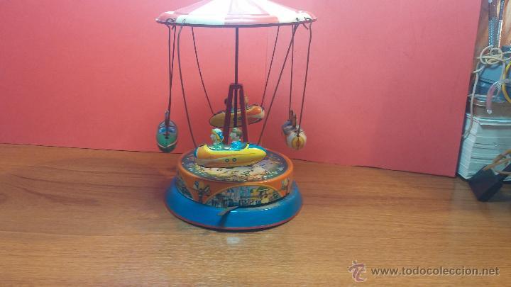 Juguetes antiguos de hojalata: JUGUETE CARRUSEL DE HOJALATA - Foto 18 - 105127448