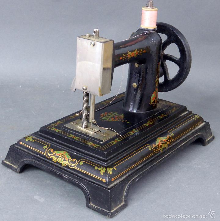Juguetes antiguos de hojalata: Máquina de coser Baby París Hierro litografíado Unis France años 30 no funciona - Foto 4 - 57185093