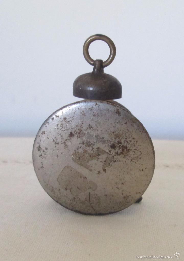 Juguetes antiguos de hojalata: Antiguo mini reloj en lata - Foto 4 - 58447837