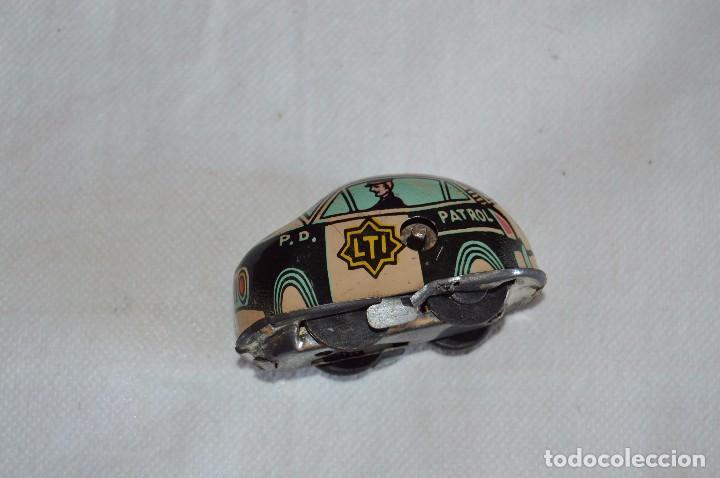 Juguetes antiguos de hojalata: ANTIGUO JUGUETE DE HOJALTA - LTI POLICE PATROL CAR - A CUERDA - AÑOS 70 - VINTAGE - ESCUCHO OFERTAS - Foto 6 - 98845435